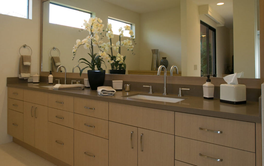 A beautiful, contemporary bathroom remodel with maple, Euro-style cabinetry and caramel-colored countertops