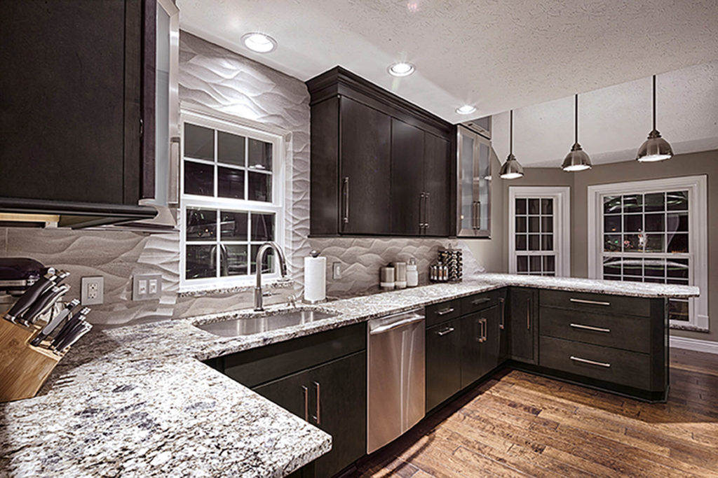 A beautiful kitchen featuring dark-finish Wellborn cabinets, with gray stone countertops and backsplash