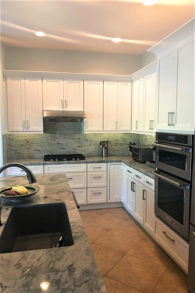 Shaker style kitchen cabinets with white finish