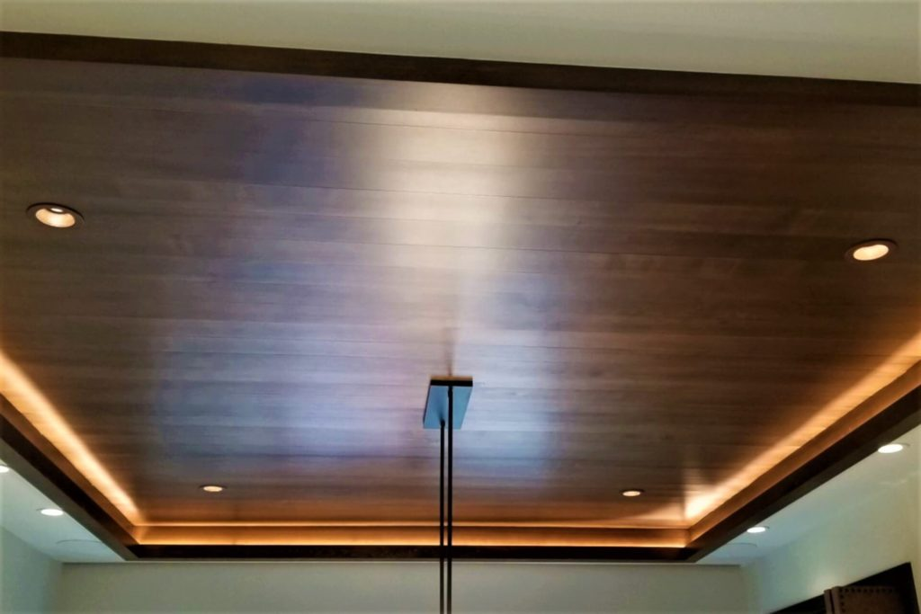 Beautiful recessed ceiling with wood panel finish